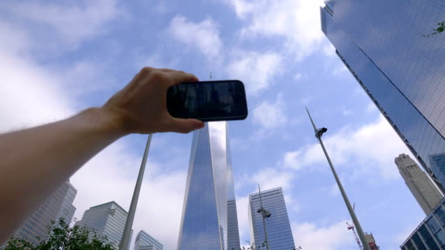 POV on Tourist Photographing Financial District in NYC in 4K Slow motion 60fps video