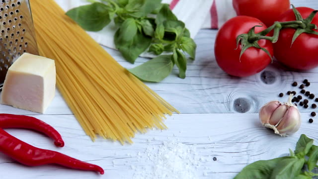 On wooden table ingredients for cooking pasta popular Italian dish video