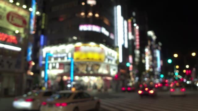 On-board - View of Tokyo Shinjuku Kabuki-cho downtown on the weekend at night SoftFocus