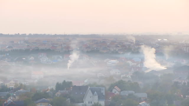 Once charming town covered in thick layer of smog from industrial factories video