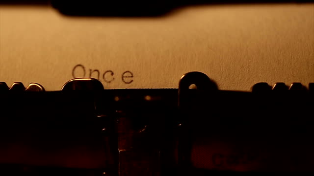 'once upon a time ' typed using an old typewriter - fiaba video stock e b–roll