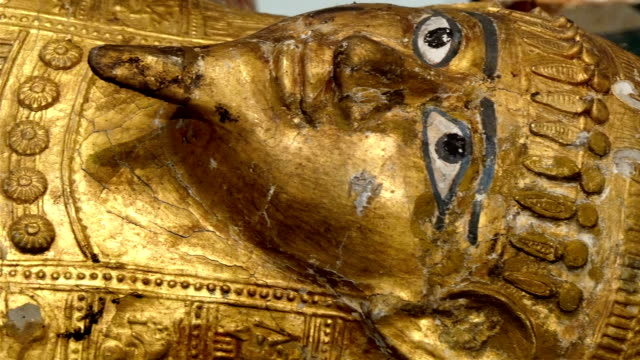 One big golden statue of the Egyptian pharoah video