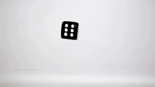 One black dice number six in slow motion rebounding video
