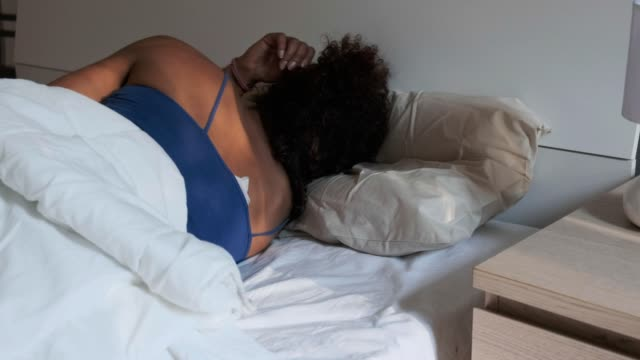 One black woman sleeping and snoring in bed Video is about one black woman sleeping and snoring in bed insomnia stock videos & royalty-free footage