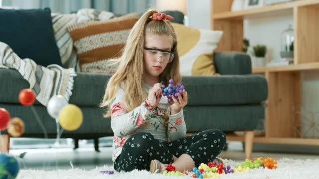 one day her scientific discoveries will change the world - occhiali protettivi video stock e b–roll