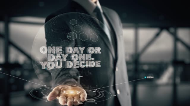 One day or day one. You decide, with hologram businessman concept