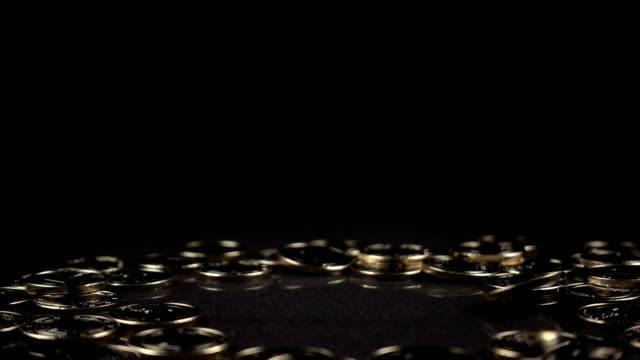 one euro coin spinning on a black background video