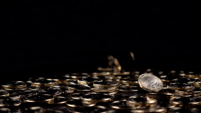 one euro coins fall on a black background video