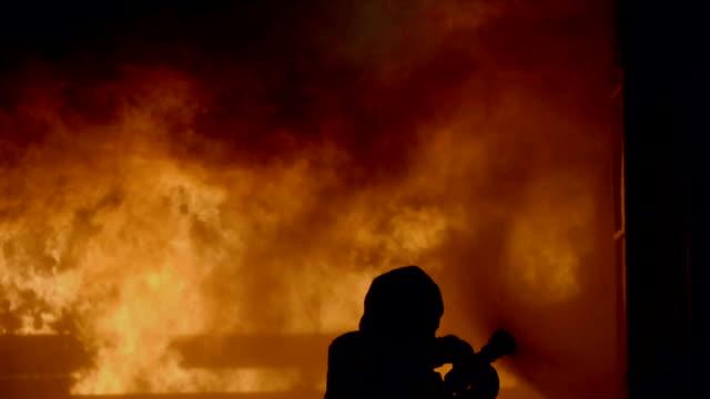 one female firefighter - potere femminile video stock e b–roll