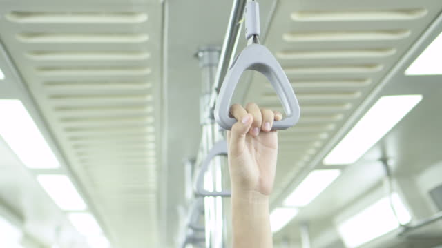 One hand hold handrail in subway or bus with copy space