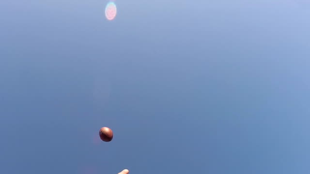 One handed juggling footbal catch in slow motion video