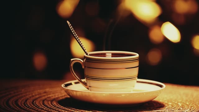 one hot tea cup spoon gold bokeh nobody hd footage - teapot stock videos & royalty-free footage