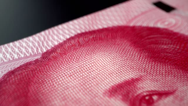 One hundred China Yuan paper banknote in close up macro view dolly shot.
