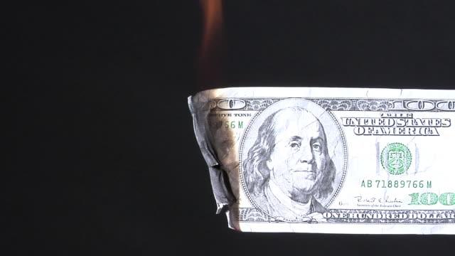 One hundred dollar bill burning video