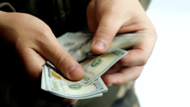 One hundred dollar bills in the hands of man, bulkhead is money video