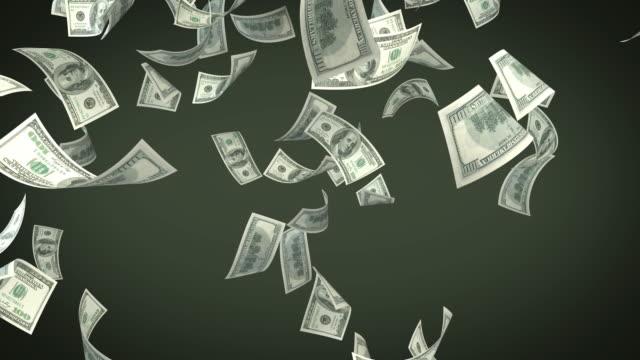 One Hundred USD Dollar Bills Falling On Green Background video
