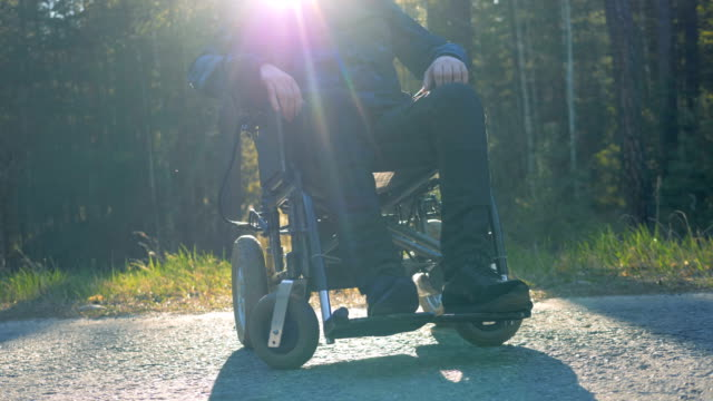 One man in a modern wheelchair, close up. video