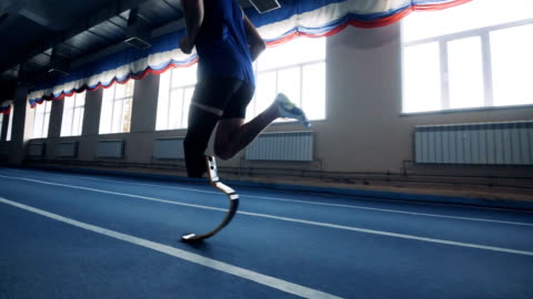 One man running with prosthetic leg, side view. Person jogging with leg prosthesis. limb body part stock videos & royalty-free footage