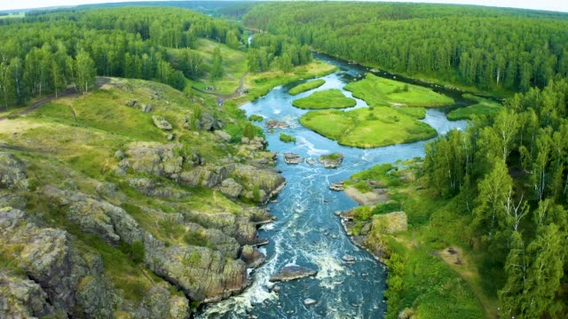 one of the popular tourist places near yekaterinburg, the river iset threshold revun, a close-up view of the whirlpools and the river from a drone. - monti urali video stock e b–roll