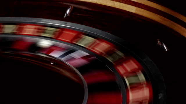 One part of roulette wheel running, white ball falls video