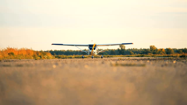 One plane on an airfield, close up. A plane working on an airfield. propeller airplane stock videos & royalty-free footage
