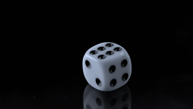 SLO MO LD One playing dice rolling on black surface