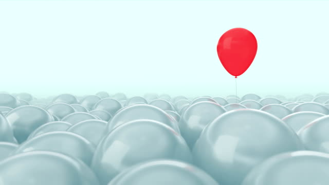 One red balloon is opposed by many other balloons. Bright blue light background. Ideal title text background. One against all. Concept ideas. The concept of personality. Use mask to easy change color.