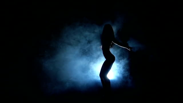 one sexy  woman stripper showgirl in silhouette studio isolated on video