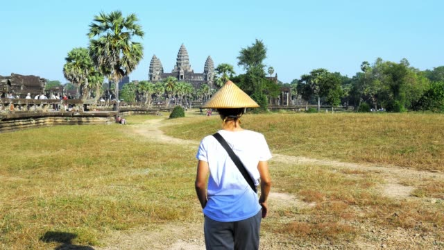 one tourist visiting angkor wat travel destination cambodia - cambogia video stock e b–roll