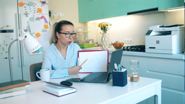 One woman works from home on laptop during quarantine. Distance education, distance learning, online education concept. video