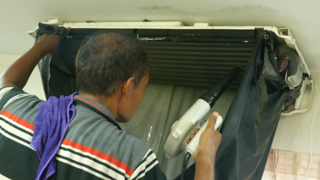 one worker cleaning air-conditioner video