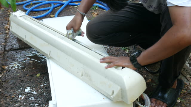 one worker cleaning path of air-conditioner video