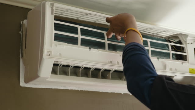 One worker repairing air conditioner Removing dirty filter of air conditioner Split-system for cleaning and washing appliance stock videos & royalty-free footage