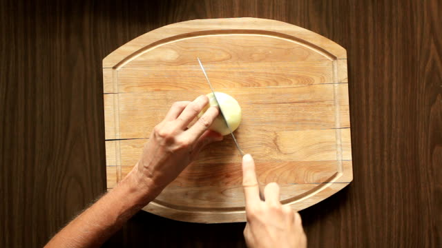Onions human hands cutting onions into a slices with sharp table knife onion stock videos & royalty-free footage
