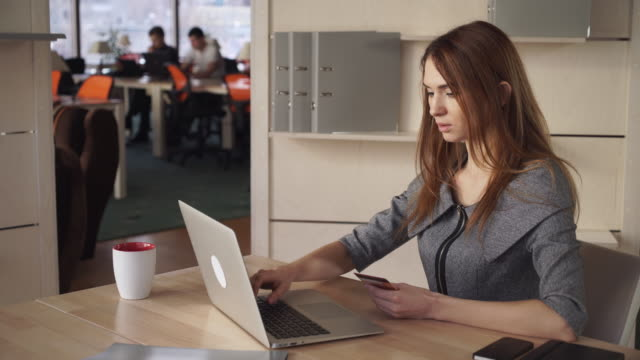 Online Banking. Beautiful Woman Pay By Credit Card At The Working Place video