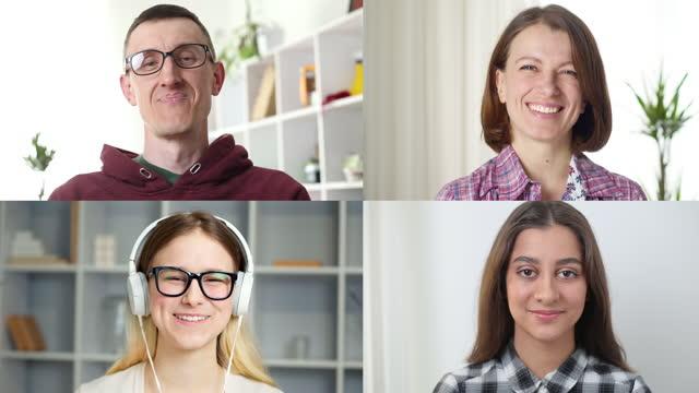 カメラを見ているオンライン会議の人々。画面上の幸せな顔のコラージュ。リモートコミュニケーションの学生のための教育ウェビナー。ウェブカメラ、4k。 - 人里離れた点の映像素材/bロール