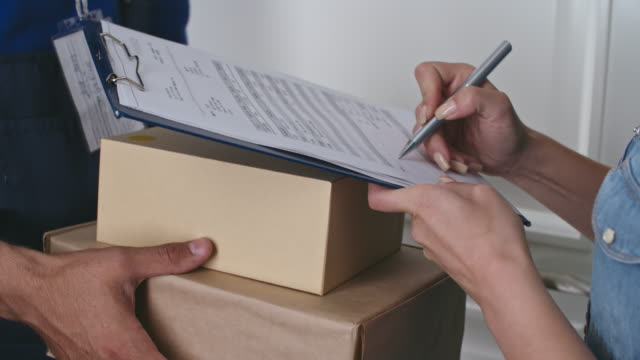 Online Customer Receiving Packages from Delivery Person