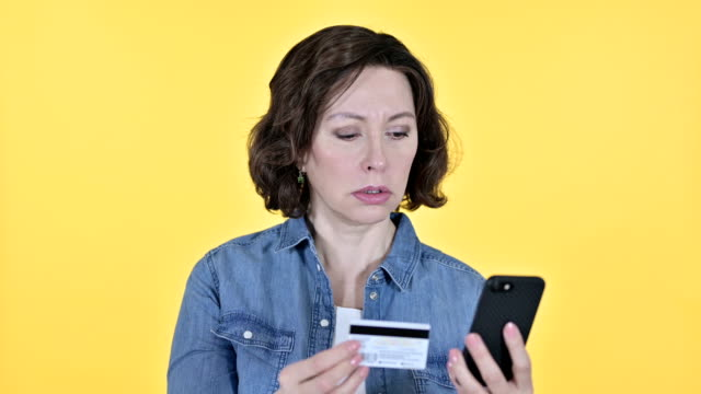Online Payment on Smartphone by Old Woman, Yellow Background