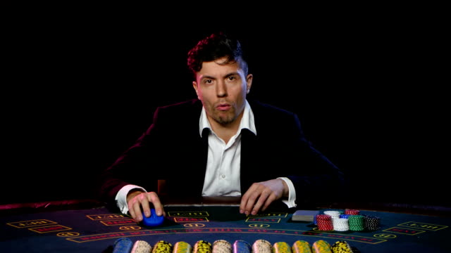 Online poker player with chips and winning at casino table. Close up video