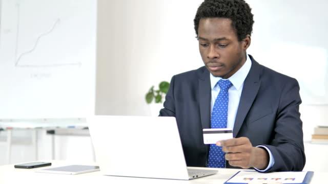 online shopping by african businessman, banking - credit card filmów i materiałów b-roll