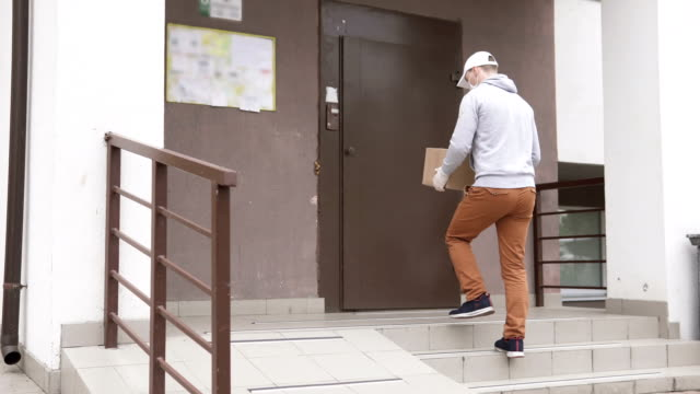 Online shopping. Delivery of the package to the house during the quarantine period. video