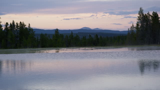 Opal Pool Surrounded by Forest at Dusk/Sunset in Yellowstone National Park in Wyoming