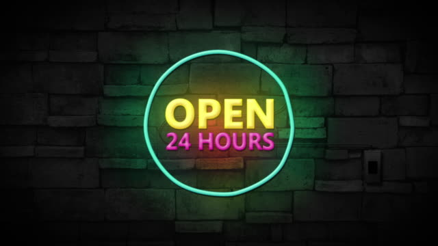 Open 24 hours neon sign on brick wall background. Business and service concept.