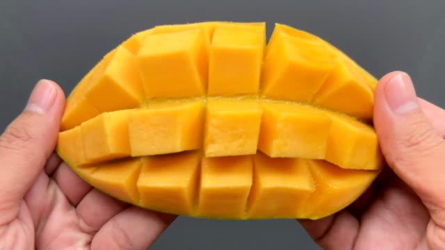 Open a cut mango in 4K resolution Open a cut mango in 4K resolution mango stock videos & royalty-free footage