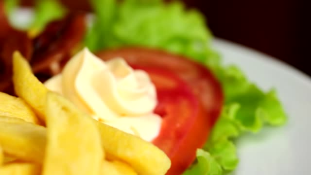 Open Burger on a plate Open burger on plate with egg, bacon and salad tomato salad stock videos & royalty-free footage