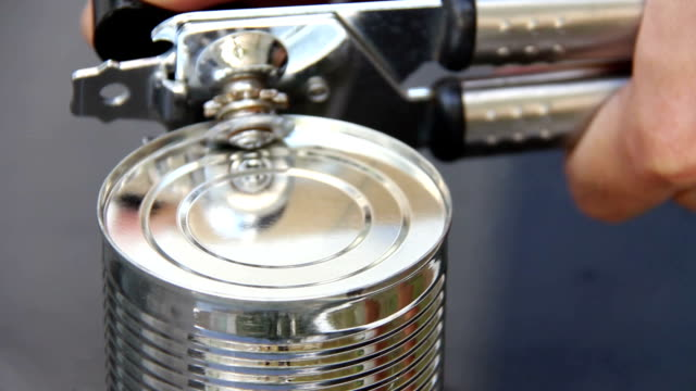 open condensed milk can by canning tool