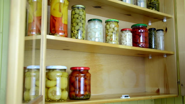 open cupboard jar girl hand opens a wooden cupboards door and take all the jars from the shelf cabinet stock videos & royalty-free footage