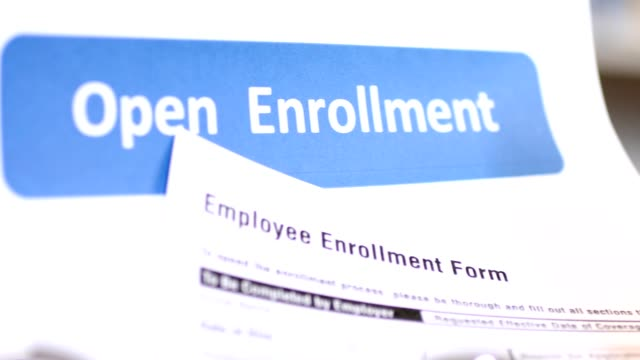 vídeos de stock e filmes b-roll de open enrollment healthcare benefit forms. - medicare
