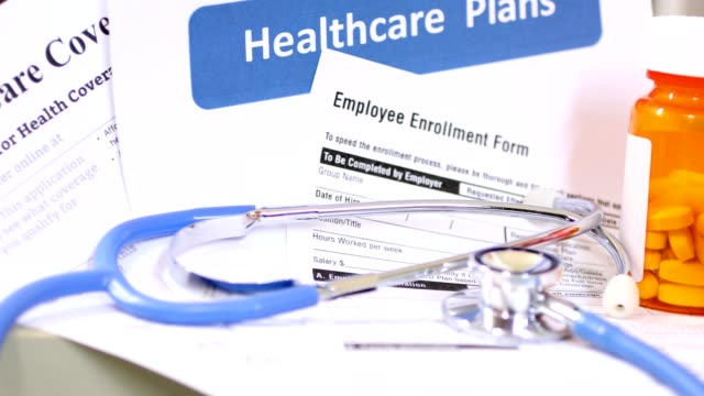Open enrollment healthcare benefit forms. Healthcare benefit forms including: enrollment forms and applications, stethoscope and other medical and office items.  Affordable healthcare remains an important topic around the world! medicare stock videos & royalty-free footage
