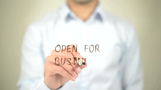 Open for Business,  Man writing on transparent screen video